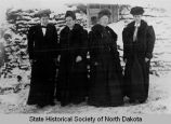 Mrs. Ole Olson, Mrs. Pete Sands, Mrs. Andrew Olson, and Mrs. John Krogstad in front of sod house