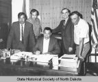 Warren Means, Nathan Little Soldier, Jim Hensy, Elmer Davis, and Arthur A. Link at a desk