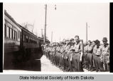 Civilian Conservation Corps members moving camp to Bismarck, N.D. from Fair Park, Arkansas