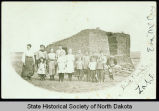 Eva McCoy and students in front of School Number 3, Zahl, N.D.
