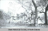 Children posing in tree, Fort Berthold Indian Reservation, N.D.