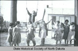 Girls on swings, Fort Berthold Indian Reservation, N.D.