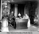 Charles L. and Susan W. Hall at desk, Fort Berthold Indian Reservation, N.D.
