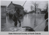 Man catching fish in floodwater, Pembina, N.D.