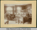 Dick Peuwarden, Leonard Bell, and Maury Pye inside First National Bank, Bismarck, N.D.
