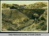 Civilian Conservation Corps men at work on stone bridge, North Dakota Badlands