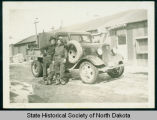Blackie Myers and another CCC truck driver at camp near Watford City, N.D.