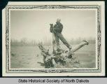 Maury Martin and Joe the Dog near Civilian Conservation Corps camp 2771 and 2772, Watford City,...