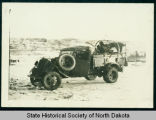 Damaged army truck, Civilian Conservation Corps camp near Watford City, N.D.
