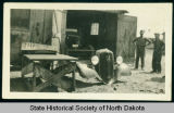 Truck repair on number 14, CCC camp 2772 near Watford City, N.D.