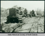 Civilian Conservation Corps men operating construction equipment