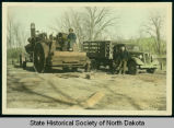 Civilian Conservation Corps men with steam tractor and truck