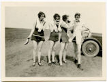Myrtle Munson, Ellen Davis, Elsie Milde, and Carl Munson eating watermelon, Wishek, N.D.