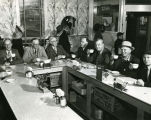 C. Norman Brunsdale and others in unidentified cafe