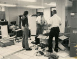 IBM personnel installing new computer equipment for State Radio System, Bismarck, N.D.