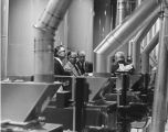 William L. Guy and others inspecting machinery at rededication of North Dakota State Mill &...