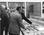 William L. Guy and others at console during rededication of North Dakota State Mill &...
