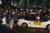 Susan Wefald riding in parade, Bismarck, N.D.
