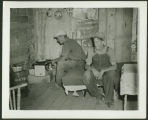 Young men cooking inside a shack, Fargo, N.D.