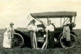 Violet West, Phil Prall and Viola West with car, Brantford, N.D.
