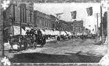 Horse drawn fire engine in parade on Main Avenue, Bismarck, N.D.