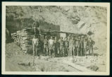 Civilian Conservation Corps members constructing a stone shelter, Theodore Roosevelt National...