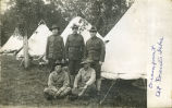 Lynn Sperry with soldiers at encampment, Devils Lake, N.D.