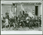 Celebrants with shotguns and instruments with Northern Pacific Railroad boxcar, Mandan, N.D.