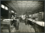 Workers inside First National Bank, Mott, N.D.