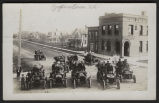 Families in touring automobiles in front of State Bank, Cooperstown, N.D.