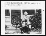 Sigrid Kjelbertson and spinning wheel, Devils Lake, N.D.