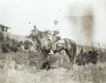 George Woodman, Jr. on horseback, H.T. Ranch near Amidon, N.D.