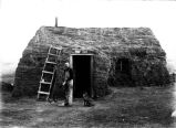 Jim Spitzer and sod house near Rice Lake, N.D.