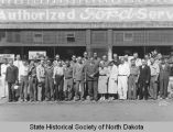 Ford employees in front of dealership, Bismarck, N.D.