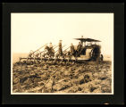 Using eight bottom plow with tractor