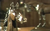 Video montage of western-themed sculptures with instrumental music overlay