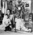Elizabeth and Elwell Treumann sitting next to Christmas tree, Grafton, N.D.