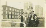 Family in front of North Dakota Mill and terminal elevator, Grand Forks, N.D.