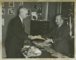 Frank A. Wenstrom presenting proposed new state Constitution to Secretary of State Ben Meier, Bismarck,