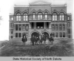 John Burke and men on horseback, North Dakota State Capitol
