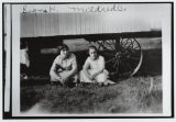 Signa Hermanson Larsen and Mildred Christenson seated next to cook car, Burke County, N.D.