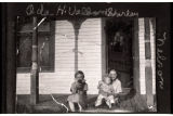 Oda H. Vallard, Shirley, and Nelson on porch, Burke County, N.D.