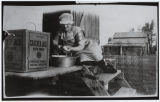 Signa Hermanson Larsen peeling potatoes for cooking, Burke County, N.D.