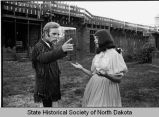 Actor portraying George Custer talking to an actress, Fort Abraham Lincoln