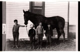Clint Haskins, Earl Graham, Gerald Haskins, Ralph Goranson in front of school #1, Lallie Township, N.D.