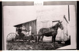 Mrs. J.R. Jenson in buggy at post office and country store, Villa, N.D.