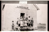 Students and teacher in front of Lincoln School No. 4, near Flaxton, N.D.