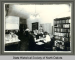 Staff of the traveling library department of the Public Library Commission in their office, Bismarck,