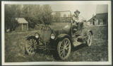 Reinhold Kundiger in 1925 automobile, Burke County, N.D.
