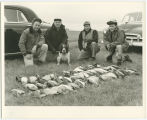 Hunters with display of game birds from the day's hunt